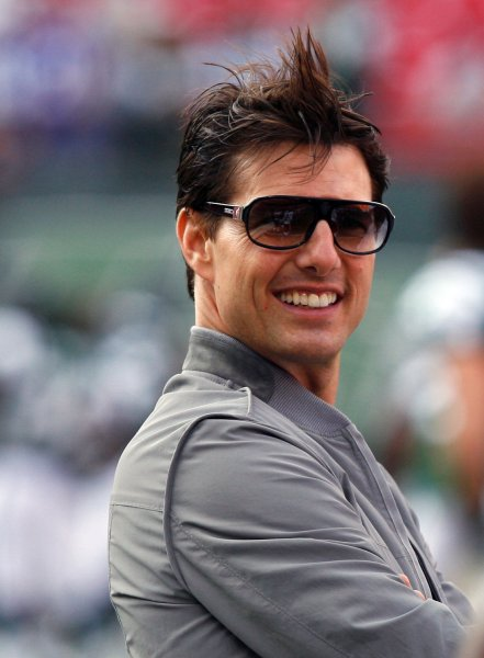 Tom Cruise stands on the field before the New York Jets play the Washington Redskins at Giants Stadium in East Rutherford, New Jersey on August 16, 2008. (UPI Photo/John Angelillo) .