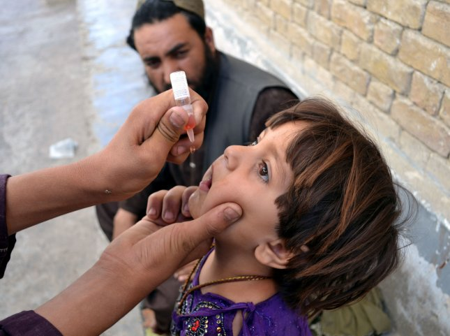 Toddler, a refugee from Syria, in Lebanon suspected of polio. UPI/Matiullah Achakzai.