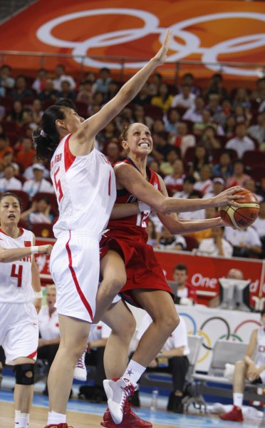 USA's Diana Taurasi (R) tries to put up a shot around Chen Nan of China at the 2008 Summer Olympics in Beijing on August 11, 2008. The USA women defeated China 108-63. (UPI Photo/Terry Schmitt)