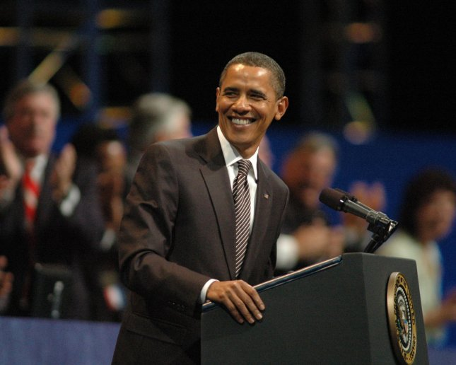 President Barack Obama smiles to the delegates at the AFL-CIO National Convention in Pittsburgh, Pennsylvania on September 15, 2009. The AFL-CIO plans to approve a resolution backing the 'public option' in health care reform. UPI/Archie Carpenter UPI/Archie Carpenter