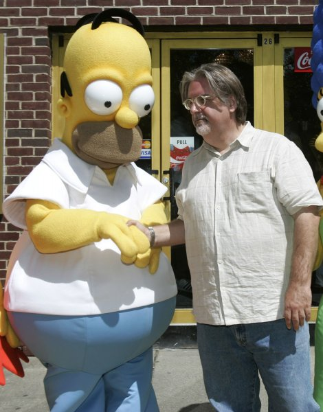 The Simpsons Movie producer Matt Groening (R) shakes hands with Homer Simpson at the premier of the movie at the Springfield Movie Theater in Springfield, Vermont, on July 21, 2007. The University of Glasgow in Scotland launched a new course examining the philosophy of Homer Simpson, titled D'oh! The Simpsons Introduce Philosophy. Photo by Matthew Healey/UPI