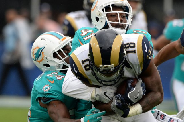 Los Angeles Rams receiver Kenny Britt (18) is tackled by Miami Dolphins Isa Abdul-Quddus (24) and Byron Maxwell (41) at the LA Coliseum in Los Angeles, November 20, 2016. Photo by Jon SooHoo/UPI
