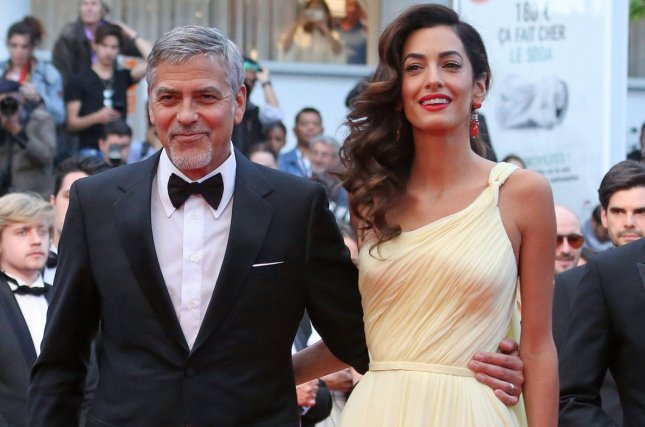 George and Amal Clooney arrive on the red carpet before the screening of the film Money Monster at the opening of the Cannes International Film Festival on May 12, 2016. The couple are expecting twins. File Photo by David Silpa/UPI
