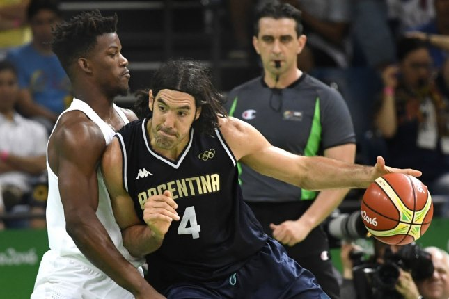 Argentina's Luis Scola (R) looks to drive against the United States' Jimmy Butler during the USA vs Argentina Men's Quarterfinal basketball game at the 2016 Rio Summer Olympics in Rio de Janeiro, Brazil, August 17, 2016. Photo by Mike Theiler/UPI