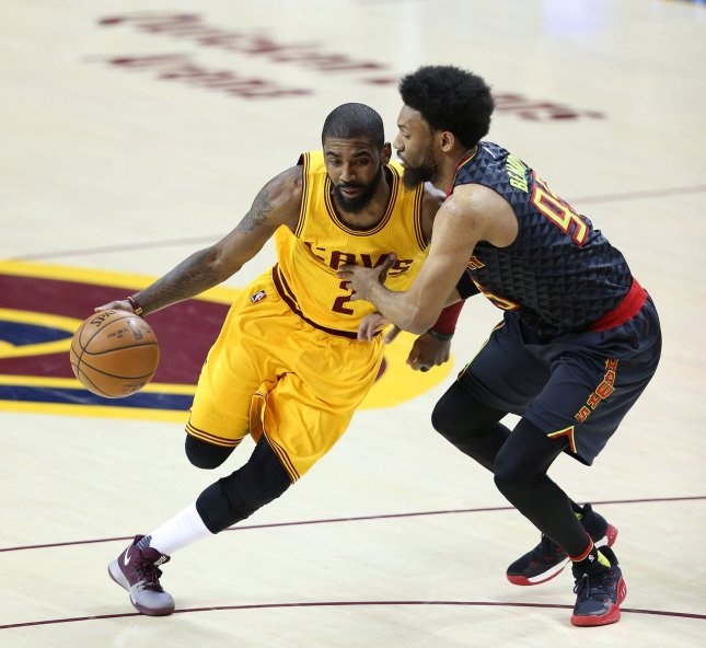 Kyrie Irving of the Cleveland Cavaliers drives to the basket in a game against the Atlanta Hawks last season. Photo by Aaron Josefczyk/UPI