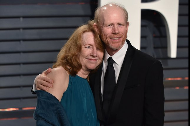 Director Ron Howard and his wife Cheryl attend the Vanity Fair Oscar Party on February 26. Howard announced the offcial title for the Han Solo spinoff film on Twitter. File Photo by Christine Chew/UPI