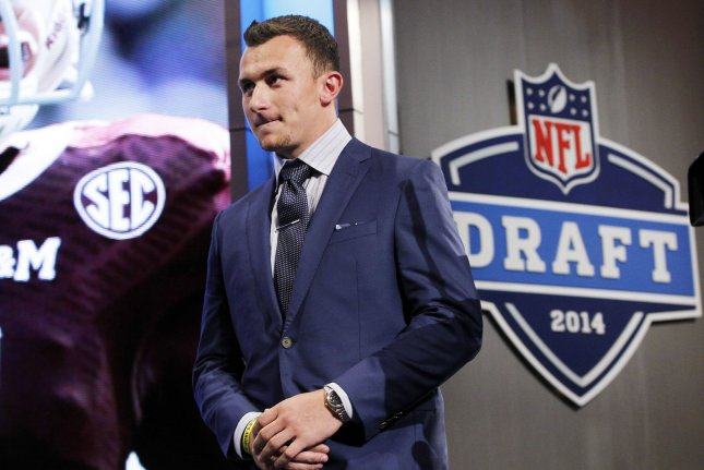 Former Texas A&M quarterback Johnny Manziel walks on the stage before the start of the 2014 NFL Draft at Radio City Music Hall in New York City. File photo by John Angelillo/UPI