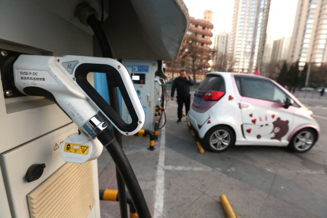 A man prepares to charge his electric vehicle at a charging station in Beijing, China. A new survey Tuesday shows more Americans than ever say they'll consider buying a fully electric vehicle when they are next in the market for a car. File Photo by Stephen Shaver/UPI