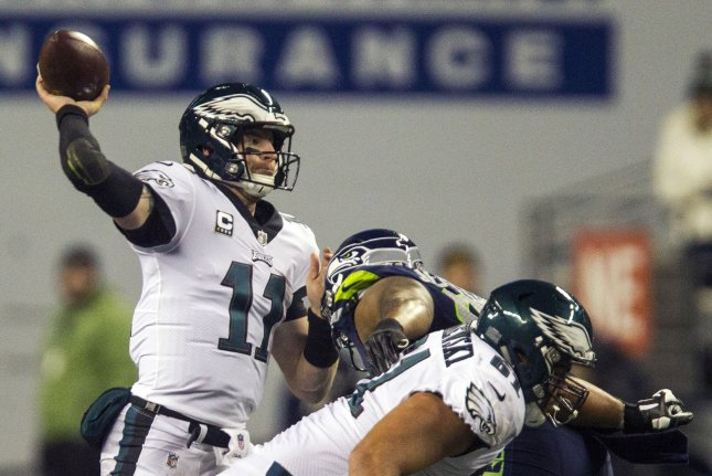 Philadelphia Eagles quarterback Carson Wentz passes under pressure from Seattle Seahawks defensive tackle Jarran Reed (90) during their game at CenturyLink Field in Seattle, Washington on December 3, 2017. Photo by Jim Bryant/UPI
