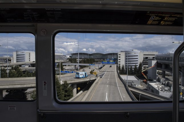 Very light traffic is seen from the Red Line Train at San Francisco International Airport in San Francisco on Thursday. Minimal passenger traffic is arriving or departing SFO as the Bay Area starts a three-week shutdown because of Coronavirus. Photo by Terry Schmitt/UPI
