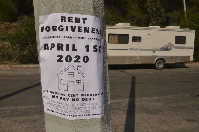 A sign is pictured on March 28 near a self-testing coronavirus site in Los Angeles, calling for a rent moratorium. Photo by Jim Ruymen/UPI