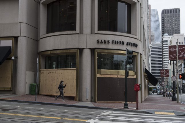 A Saks Fifth Avenue store is seen closed and boarded up in Union Square in San Francisco, Calif., on April 11. The high-end retail area was shut down due to restrictions and threats stemming from the coronavirus outbreak. File Photo by Terry Schmitt/UPI