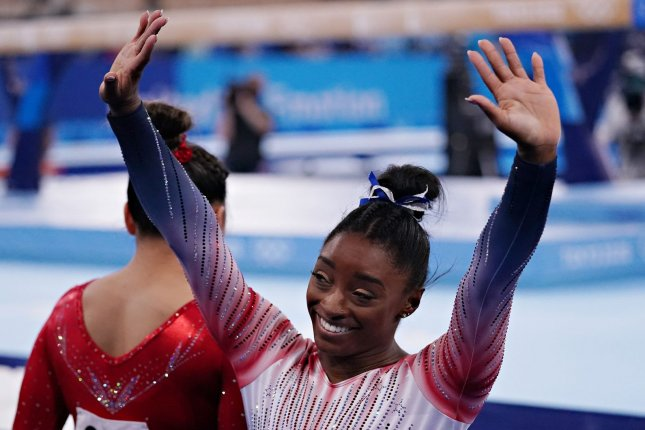 Team USA's Simone Biles waves to supporters during the balance beam competition at the 2020 Summer Games on Tuesday in Tokyo. Photo by Richard Ellis/UPI