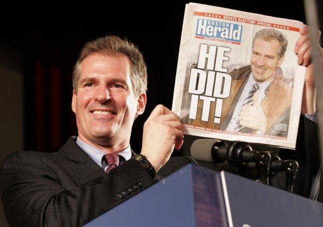 Newly elected U.S. Senator Scott Brown (R-MA) holds up a special edition of the Boston Herald declaring him the winner during his victory speech at the Park Plaza in Boston, Massachusetts on January 19, 2010. Brown defeated Democrat Martha Coakley in a bid to fill the U.S. Senate seat which was left empty after the death of Senator Edward M. Kennedy (D-MA). UPI/Matthew Healey
