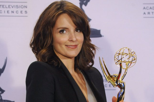 Actress Tina Fey appears backstage with her Emmy for Outstanding Guest Actress in a Comedy Series for her turn as former Alaska Gov. Sarah Palin on Saturday Night Live, at the Creative Arts Emmy Awards. (File/UPI/Jim Ruymen)