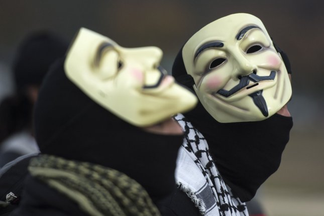 """Demonstrators wearing Guy Fawkes masks prepare to march in the Million Mask March, an anti-establishment protest expected to take part today in over 670 cities worldwide, in Washington, D.C. on November 5, 2015. The march, allegedly organized by Anonymous, the """"hacktivist"""" group linked to cyber-attacks against governments and multi-national corporations, aims at protesting government overreach and corporate greed, among other grievances. Photo by Kevin Dietsch/UPI"""