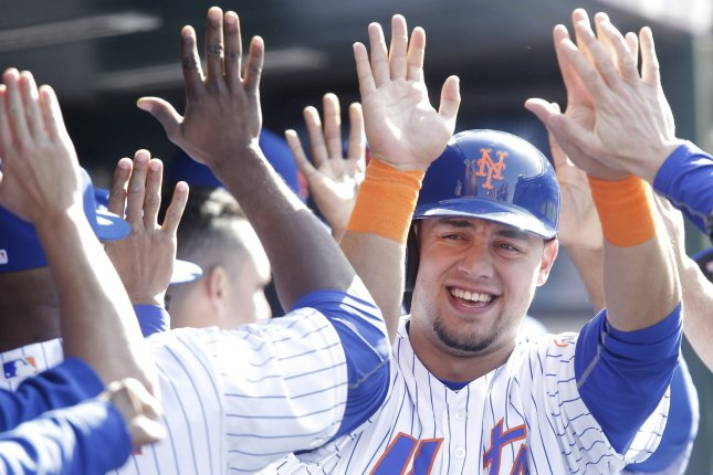 New York Mets' Michael Conforto celebrates after scoring a run. File photo by John Angelillo/UPI