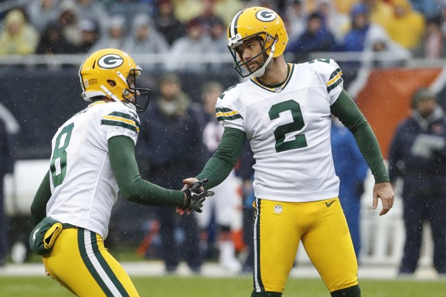Green Bay Packers kicker Mason Crosby (2) celebrates with former Packers punter Justin Vogel (8) after scoring a field goal against the Chicago Bears during the first half on November 12, 2017 at Soldier Field in Chicago. Photo by Kamil Krzaczynski/UPI