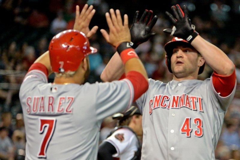 Cincinnati Reds' Scott Schebler (R) celebrates with Eugenio Suarez. Photo by Art Foxall/UPI