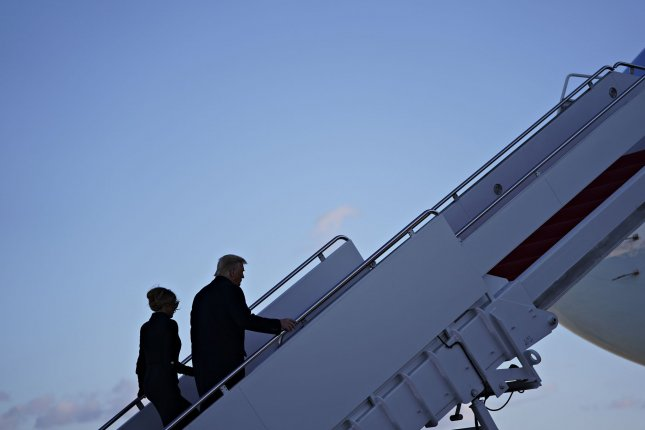 President Donald Trump and first lady Melania Trump climb the stairs to Air Force One for the final time on Wednesday during a farewell ceremony at Joint Base Andrews in Maryland. Photo by Stefani Reynolds/UPI