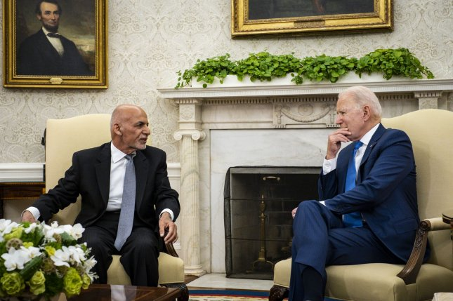 U.S. President Joe Biden listens to Afghan President Ashraf Ghani in the Oval Office of the White House in Washington, D.C., on June 25. File Photo by Pete Marovich/UPI/Pool