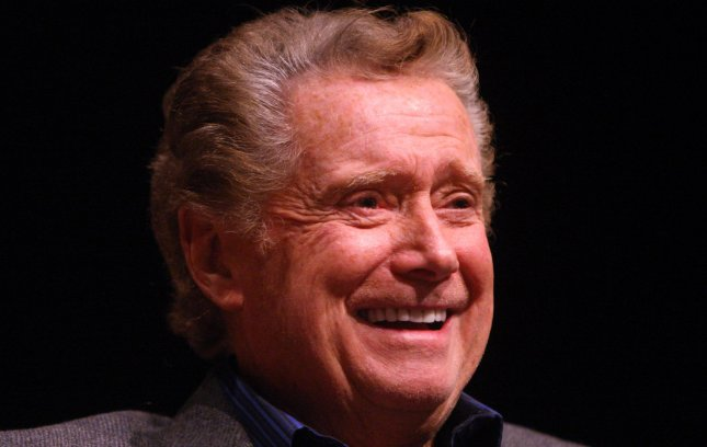 Talk show host Regis Philbin laughs as he is interviewed on the stage at the Skip Viragh Center for the Arts on the campus of Chaminade College Preparatory School in Creve Coeur, Missouri on November 29, 2011. Philbin was on hand to promote his new book, How I Got THis Way, at a book of the month club. UPI/Bill Greenblatt