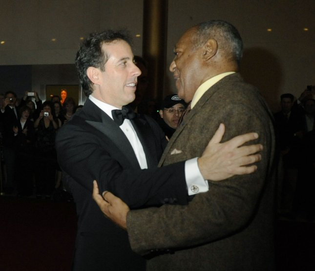 Jerry Seinfeld (L) greets Bill Cosby, recipient of the 12 Annual Mark Twain Prize, at the Kennedy Center in Washington on October 26, 2009. UPI/Alexis C. Glenn