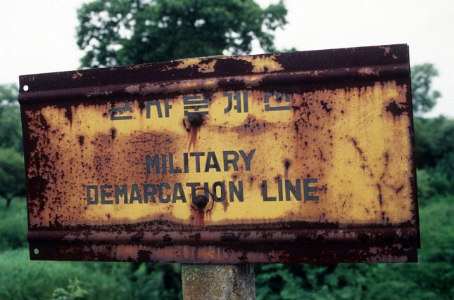 This undated Department of Defense photo shows a sign in the Demarcation Line (MDL) separating North and South Korea. On Monday, May 25, 2009 North Korea allegedly detonated a nuclear device during an underground test and test fired several short range missile. North Korea announced that it has restarted its nuclear weapons research program. (UPI Photo/Scott Stewart/USAF)