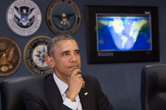 President Barack Obama receives an update on the 2016 Atlantic hurricane season at FEMA's National Response Coordination Center in Washington, D.C., on Tuesday. The president advised residents to stay vigilant and to become familiar with a mobile phone app from the relief agency that officials say can provide substantial help in the case of an emergency. Photo by Kevin Dietsch