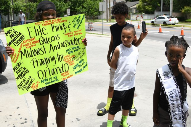Orlando's gay community is reaching out for help to block Westboro Baptist Church members from protesting the funerals of Pulse nightclub shooting victims. Pictured: Miss Prescott and her children traveled from Kansas to show support for the families of the nightclub massacre. Omar Mateen shot and killed 49 patrons and wounded another 53 at the Pulse gay nightclub in Orlando. Photo by Gary I Rothstein/UPI