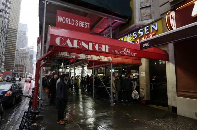 Two long lines of customers wait to enter Carnegie Deli Restaurant on the eve of its last day of business in New York City on Thursday. The Carnegie Deli opened in 1937 on Seventh Avenue across from Carnegie Hall. Photo by John Angelillo/UPI