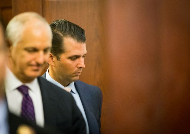 Donald Trump Jr. (R) walks into a meeting about his role in a meeting with a Russian lawyer during the 2016 election, on Capitol Hill in Washington, D.C. on Thursday. Trump Jr. was adamant in his remarks during the meeting that he did not collude with Russia to influence the election. Photo by Erin Schaff/UPI
