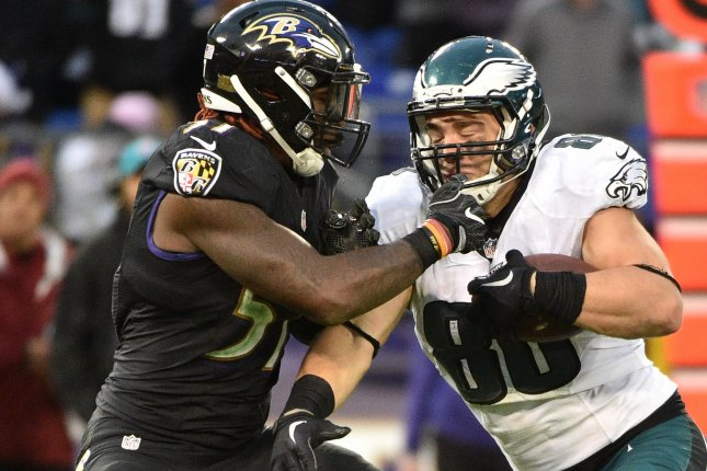 Baltimore Ravens linebacker C.J. Mosley (57) stops Philadelphia Eagles tight end Zach Ertz (86) by his face mask during the second half of an NFL game on December 18 at M&T Bank Stadium in Baltimore, Md. File photo by David Tulis/UPI