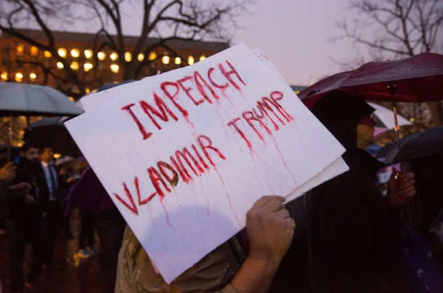A protester holds a sign that states Impeach Vladimir Trump at the 'Resistance Address' rally in Lafayette Park, next to the White House where advocacy groups gathered to denounce President Donald Trump and his policies before his first address to Congress in Washington, D.C., on February 28, 2017. Rep. Justin Amash of Michigan became the first sitting Republican in Congress to call for impeachment proceedings against Trump on Saturday night. Photo by Erin Schaff/UPI