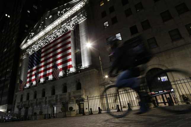 A delivery man rides a bicycle on Wall Street Tuesday near the New York Stock Exchange in New York City. Photo by John Angelillo/UPI
