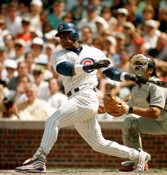 CHICAGO , ILL.,Cubs' Sammy Sosa delivers an RBI. The Cardinals' lost to the Cubs 4-3 on a two base hit in the 9th inning by Mark Grace. The Cardinals' Mark McGwire was sent to a hospital after developing cellulitis from a soft corn on his right foot. Ray Foli UPI.