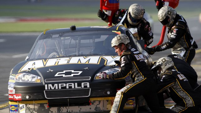 The pit crew of the U.S. Army Chevrolet, driven by Ryan Newman, hurries through a pit stop in the NASCAR Coca-Cola 600 Race at the Charlotte Motor Speedway in Concord, North Carolina on May 30, 2010. UPI/Nell Redmond .