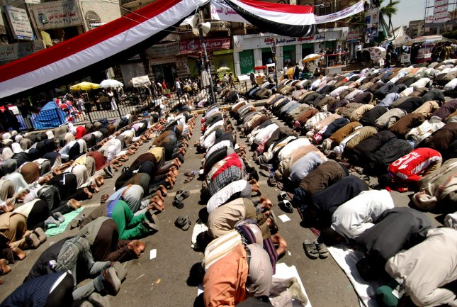 Yemeni anti-government protesters pray during demonstration outside Sanaa University to demand President Ali Abdullah Saleh's step down after three decades in power on February 26, 2011 in Sanaa, Yemen. Important Yemeni tribal leaders, including those of the Hashid and Baqil, pledged to join protests today at a gathering north of the capital. UPI