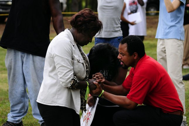 Protesters kneel and pray near the Georgia Diagnostic and Classification Prison in Jackson, Ga., on Wednesday, Sept. 21, 2011 after the state ordered the execution of death row inmate Troy Davis to be carried out by lethal injection at 7:00 p.m., for the murder of off-duty Savannah policeman Mark MacPhail, in 1989. UPI Photo/David Tulis