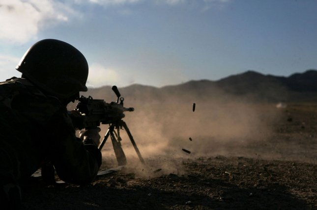 Brass is ejected from the M249 Squad Automatic Weapon fired by an Afghan national security force member during combat marksmanship practice in Now Zad, Afghanistan on Jan. 1, 2010. The Afghan military on Sept. 29, 2015, counter-attacked Taliban positions in the city of Kunduz, northern Afghanistan, after the militants seized the strategic town one day prior. Photo by Zachary J. Nola/U.S. Marines