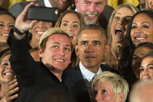 Abby Wambach holds the smartphone as U.S. President Barack Obama takes a selfie as he honors the U.S. Women's 2015 World Cup champion team at an event in the East Room of the White House in Washington DC on October 27, 2015. Obama said they inspired millions of girls to dream bigger. Photo by Pat Benic/UPI