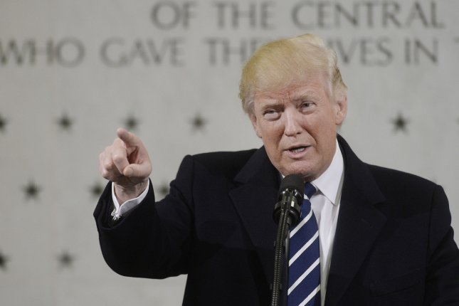 President Donald Trump speaks to 300 people at the CIA headquarters in Langley, Va., on Saturday. Trump spent part of his first full day in office praising CIA workers despite weeks of publicly feuding with the intelligence community for its assertion Russia interfered in the presidential election to help Trump win. Pool photo by Olivier Douliery/UPI