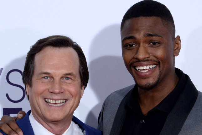 Training Day stars Bill Paxton (L) and Justin Cornwell attend the 43rd annual People's Choice Awards in Los Angeles on January 18. Training Day paid tribute to Paxton at the top of Thursday's episode after the actor died at the age of 61 Saturday. File Photo by Jim Ruymen/UPI