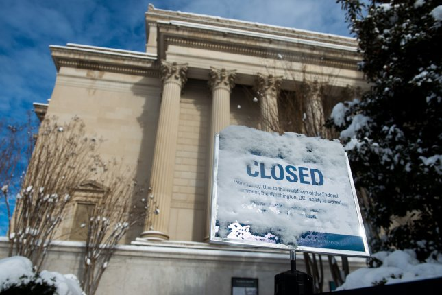 A closed sign is seen at the National Archives building in Washington, D.C., on January 14 on the 24th day of a federal government shutdown that would ultimately last for 11 more days. An agreement in principle exists to avert another shutdown this week, but it has not been finalized. File Photo by Kevin Dietsch/UPI