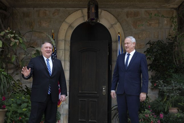 U.S. Secretary of State Mike Pompeo (L), meets Israeli Blue and White party leader Benny Gantz in Jerusalem Wednesday. Pool Photo by Sebastian Scheiner/UPI