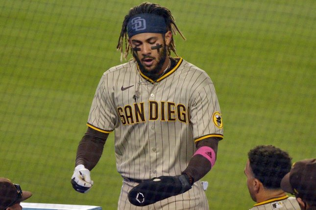 San Diego Padres shortstop Fernando Tatis Jr. returns to the dugout after scoring a run on the single by Manny Machado against the Los Angeles Dodgers on Thursday at Dodger Stadium in Los Angeles.Photo by Jim Ruymen/UPI