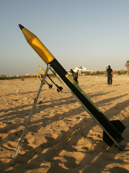 A rocket, similar to the Al-Qassam rockets used against Israeli is prepared for launch as new members of the Islamic Jihad fighters show their skills as they attend a military show in the former Israeli Jewish settlement of Atsmona on September 26, 2008 in Khan Yunis, southern Gaza Strip. Saraya Al-Quds, the military wing of the Palestinian Islamic Jihad faction graduated some 100 new members. (UPI Photo/Ismael Mohamad)