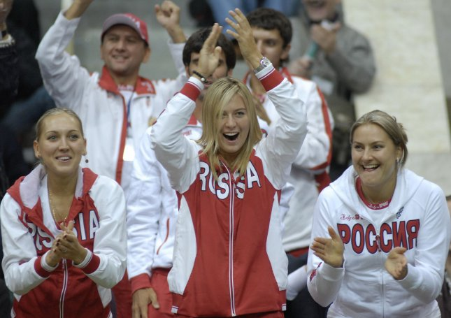 Russian tennis star Maria Sharapova (C) with Elena Vesnina (L) and Dinara Safina celebrate a game won by compatriot Anna Chakvetadze against Italian Francesca Schiavone during their Fed Cup final tennis match in Moscow on September 15, 2007. (UPI Photo/Alexander Astafiev)
