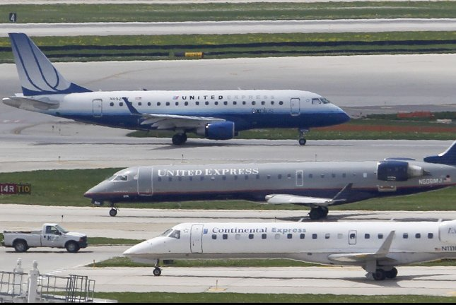 Planes from United Airlines and Continental Airlines taxi at O'Hare International Airport in Chicago. UPI/Brian Kersey