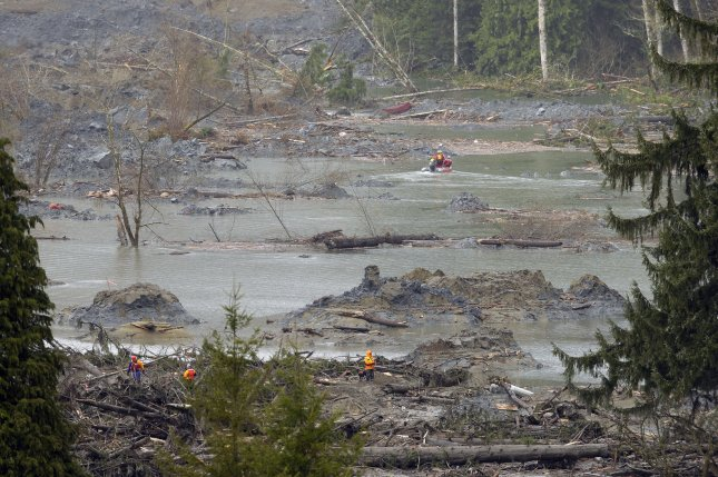 Search and rescue personnel work near the plateau above the soggy hillside on March 27, 2014 in Oso, Washington. UPI/Ted Warren/Pool